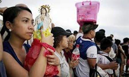 Survivors gather after Typhoon Haiyan strike Philippines.