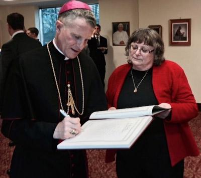 Ms. Anne Butta (right) with Archbishop Timothy P. Broglio.