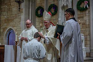 Catholic Bishop Leonard P. Blair ordains Philip O'Neill a transitional deacon on Dec. 12, 2015, in Bloomfield, Conn. Photo courtesy of Aaron Joseph.