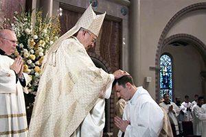 Bishop Douglas Deshotel ordains Rev. Mr. Rene Pellessier a Catholic transitional deacon Saturday, May 28, in Lafayette, La.