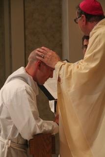 Bishop James Patrick Powers ordains Deacon Samuel Schneider Sunday, June 5, in Superior, Wis. Photo Courtesy Gerald Lieberg | Superior Catholic Herald.