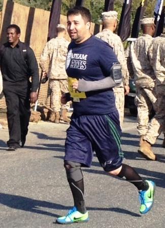 AMS Assistant Director of Development Matthew Lockwood runs in Marine Corps Marathon Sunday, Oct. 27, 2013 in Washington, D.C.