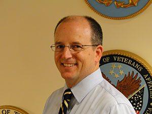 Dr. Mark Moitzoa